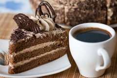a cup of gourmet coffee and cake